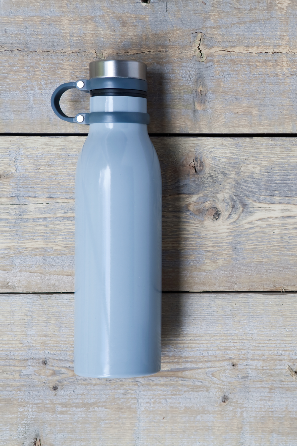 Blue reusable water bottle for at home workout