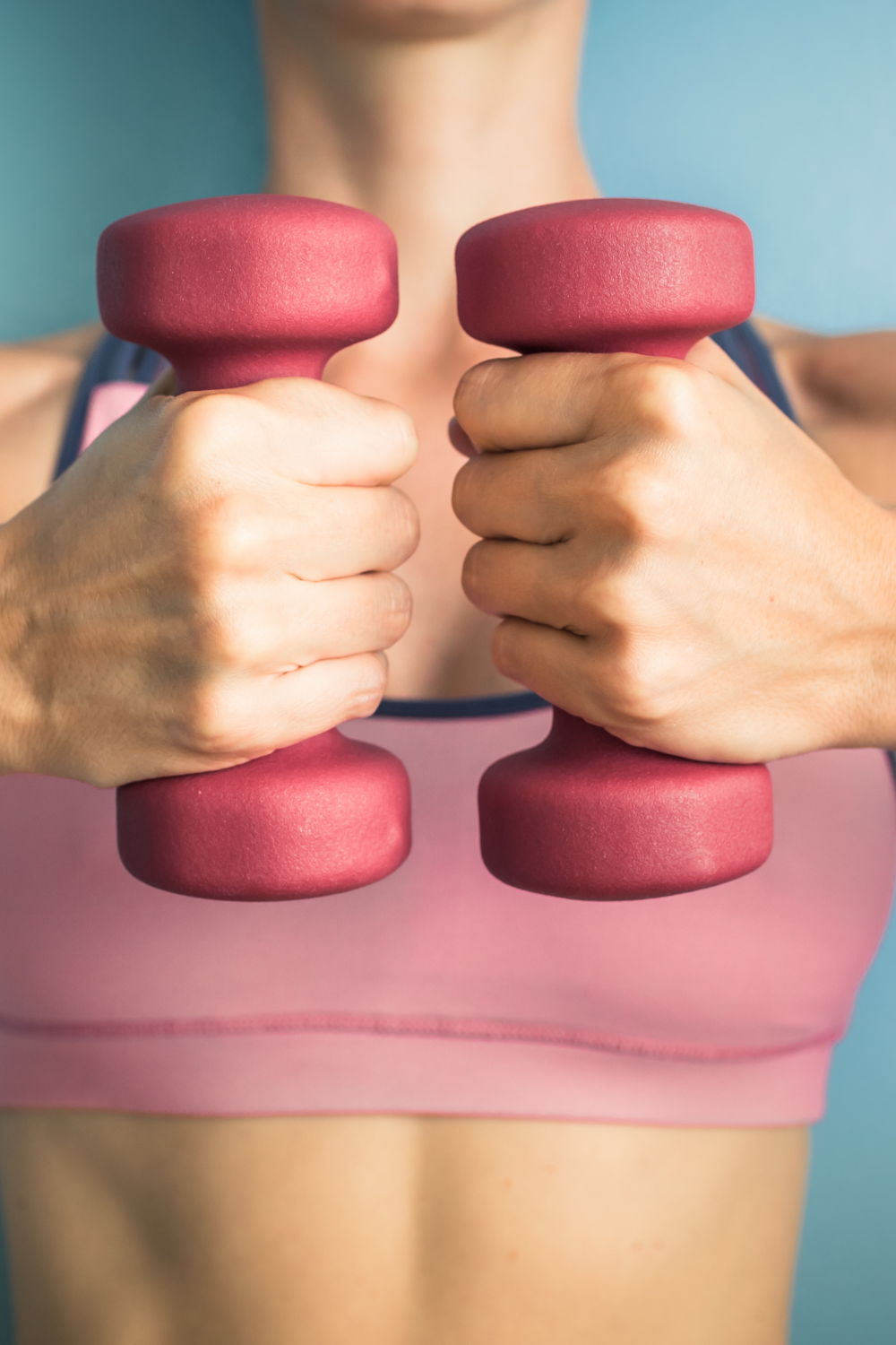 Woman holding dumbells